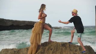 Topless Kate Upton Almost gets Knocked off jagged rocks by a wave!