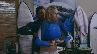 Estella Warren gets stuck in a wetsuit